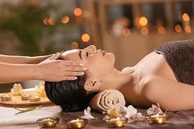 Beautiful young woman receiving massage in spa salon.jpg