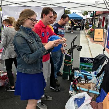 FYD members assisting at local festival
