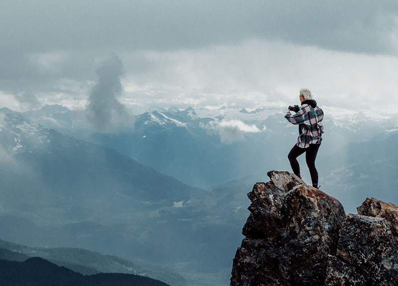 Woman standing on cliff