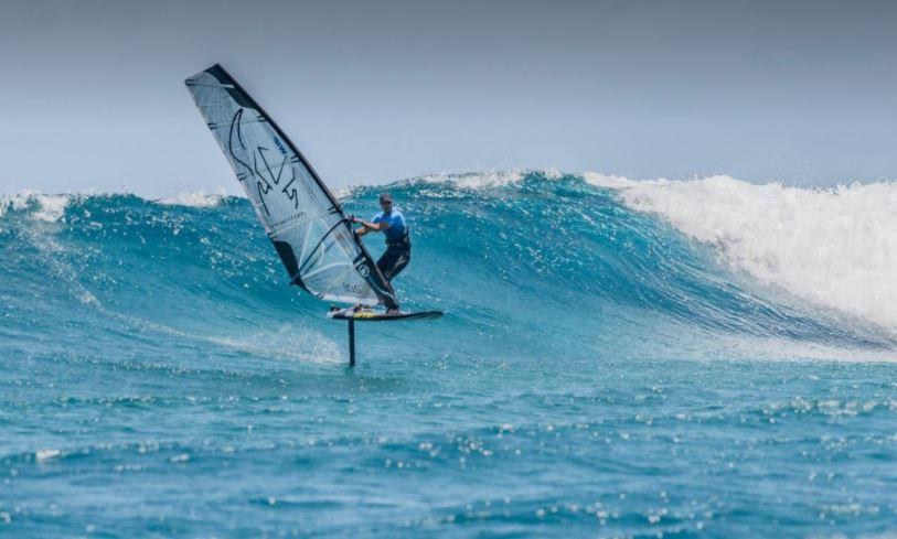 Benjamin Tillier foiling on a wave in Noumea