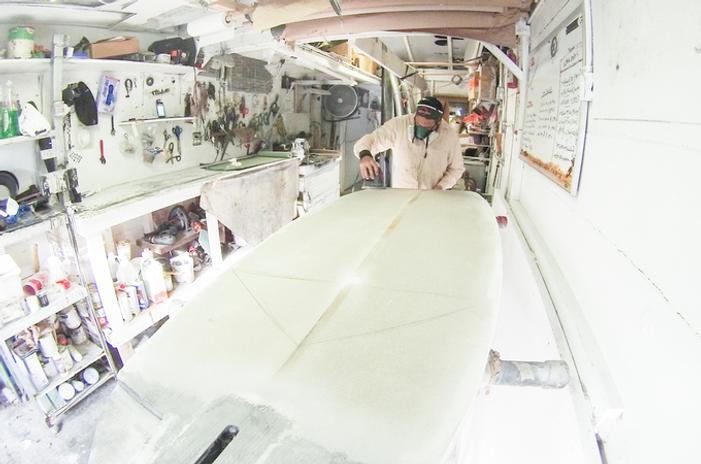 Alex Morales from Tillo International shaping a windsurf board