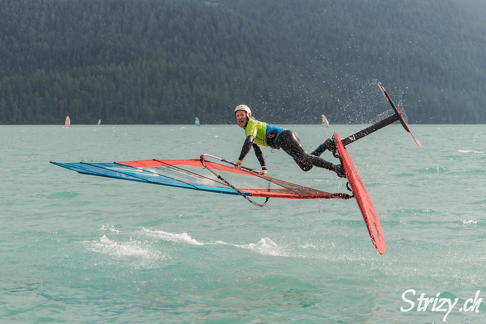 Balz Müller upside down jumping on his windfoil Lokefoil at Silvaplana