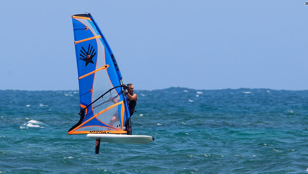 David Ezzy foiling on Ezzy Hydra windfoil sail