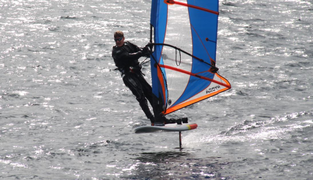 windfoiling with lip sunglasses