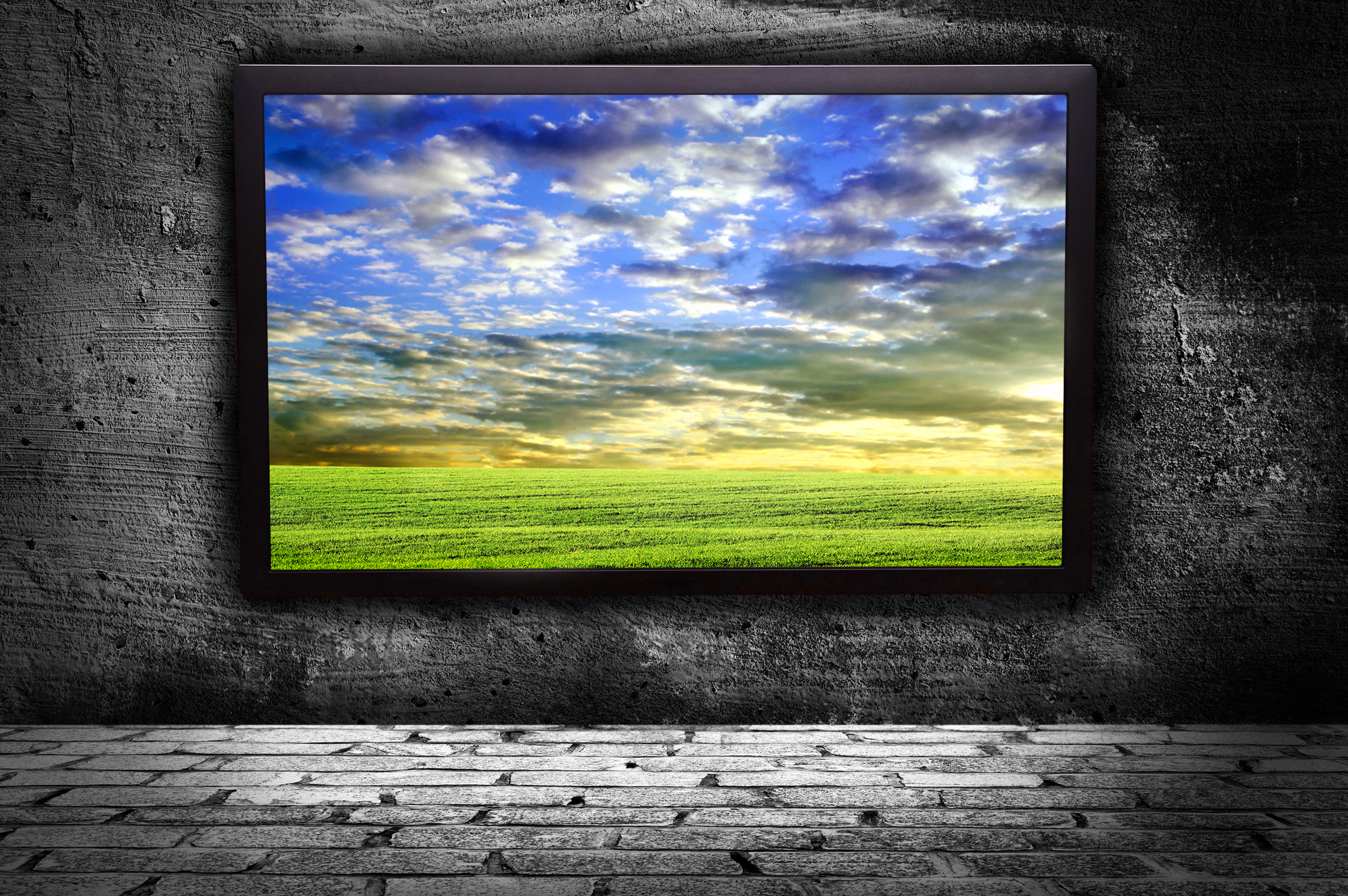 monitor with thea picture of of pure field against the gray walls