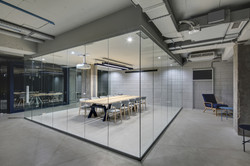 Luminous conference zone in the office in a loft style with brick walls and concrete columns.jpg