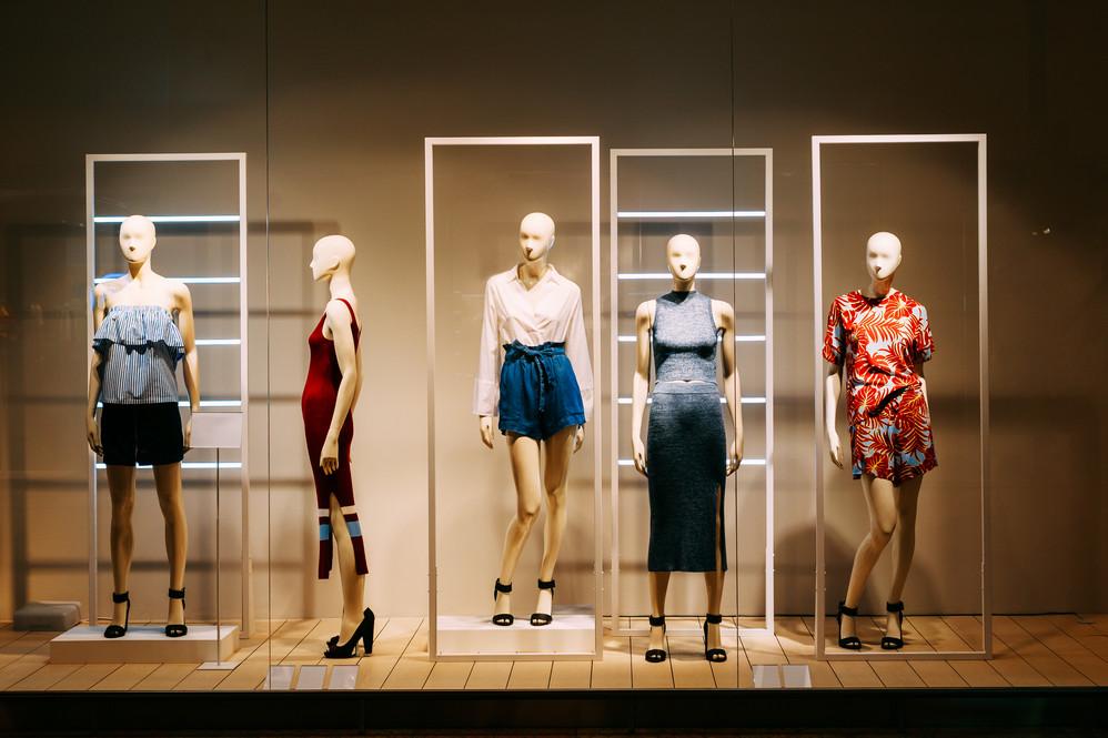 five-mannequins-standing-in-store-window