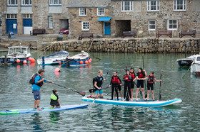 Cornwall_hugs_Grenfell©AdamGibbard-33_Survivors_and_choristers_Mousehole_harbour_including_George_Warren.jpg