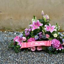 Devant de tombe rose