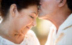 Elderly Man Kissing Wife's forehead