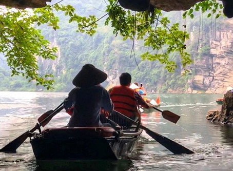 Boating through the Caves of Trang An in Ninh Binh, Vietnam.