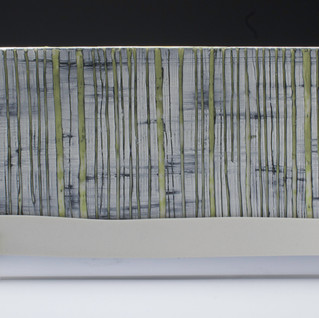 Carol Snyder (Contemporary) 'Birch and Moss, Mt. Lafayette', 2019  Wall piece   High fired porcelain, incised and inlaid tile mounted to plexiglass 6h x 15 1/2w inches  $700