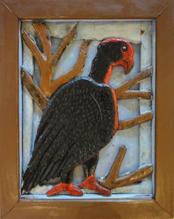 """Elijah Pierce (1892-1984) """"Buzzard"""", 1948  Carved and painted wood relief mounted on panted corrugated cardboard 16 x 12 ⅞ inches Signed and date verso: E. Pierce 1948:   Sold"""
