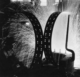 """Margaret Bourke-White (1904-1971) """"Welding Tire Rims, International Harvester"""", 1933  Platinum print 16 x 20 inches Edition: c. 50 Printed: 1999 Embossed and stamped on verso – LIFE (limited edition print in association with the estate of Margaret Bourke-White)  P.O.R."""