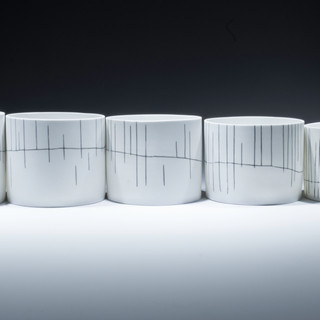 "Carol Snyder (Contemporary) 'The Way Up, Mt. Chocorua', 2019 Wheelthrown, incised and inlaid line work 3 1/2 / 4 1/4"" h x 23 1/2"" length (4 3/4"" dia each)  $2,000"