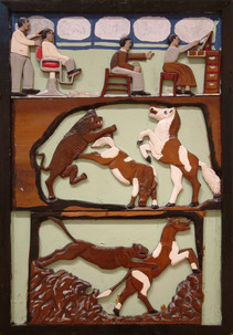 """Elijah Pierce """"Barber Shop and the Fight Against Evil"""", 1933 Painted bas relief woodcarving 31 1/2 x 21 3/4 inches"""