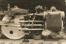 """Charles Sheeler """"Wheels"""", 1939 Gelatin silver print 6 1/2 x 9 5/8 inches Typoed title, date, photographer's credit affixed to mount verso"""