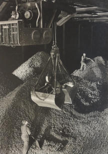 """Margaret Bourke-White (1904-1971) """"Industrial scene, giant hopper"""", c.1930s  Vintage, toned gelatin silver print; printed c.1930s 13 3/8 x 9 3/8 inches Mounted. Signed in pencil on mount recto. Photographer's credit stamp on mount verso.  P.O.R."""