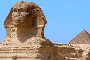 Great Sphinx and Pyramid in Giza Egypt.j