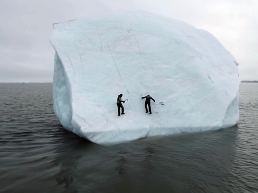 Chilling Moment Two Ice Climbers Are Plunged Into North Pole Waters When Iceberg Flips Over