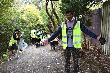 Community volunteers clean up a stream in South Auckland.