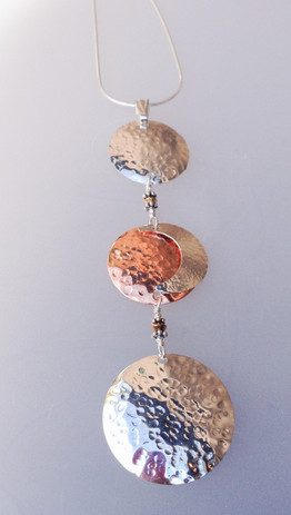 hammered-charm-with-copper-and-silver-pendant.jpg