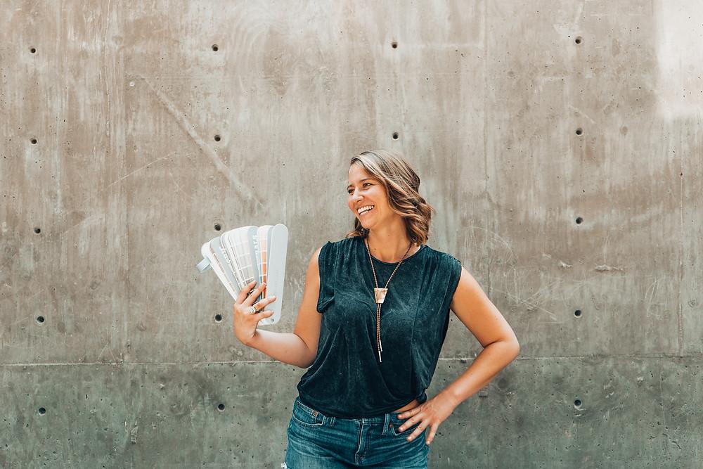 Photo of social entrepreneur Sasha West holding color palettes