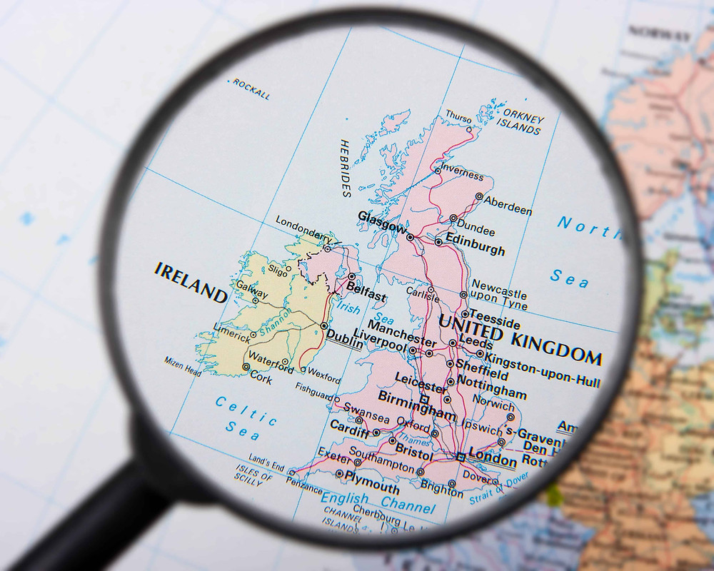 Map of the UK viewed through a magnifying glass