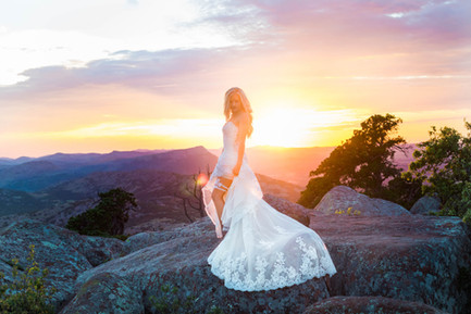 Bride on Mountain Top at Sunset