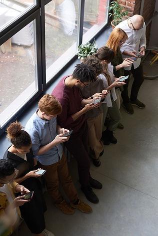 people-holding-their-phones-3184435.jpg