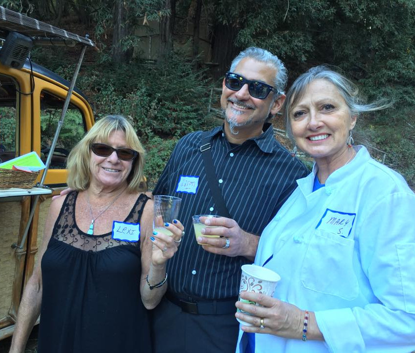 Three adults at the fundraiser