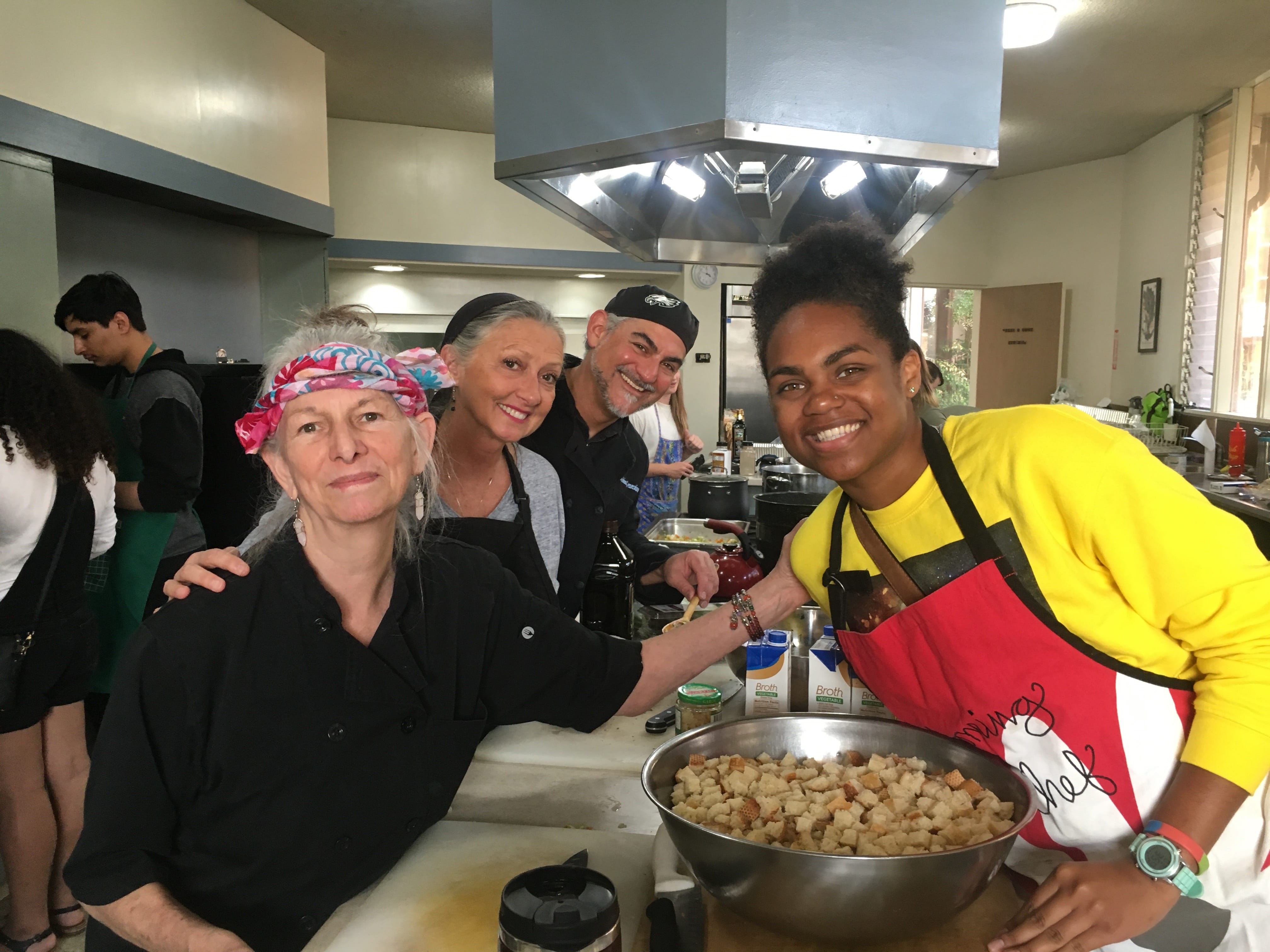 4 teachers smiling in a kitchen