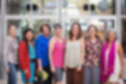 group of women standing in a line smiling