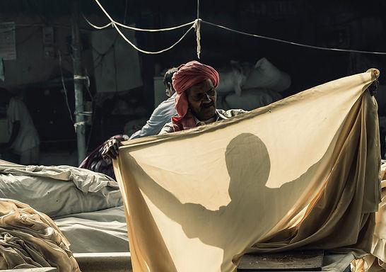 man-holding-brown-textile-2986395 r.jpg
