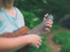 Woman playing ukulele_edited.jpg