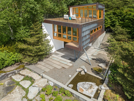 Stunning waterfront home and adorable guest cottage.
