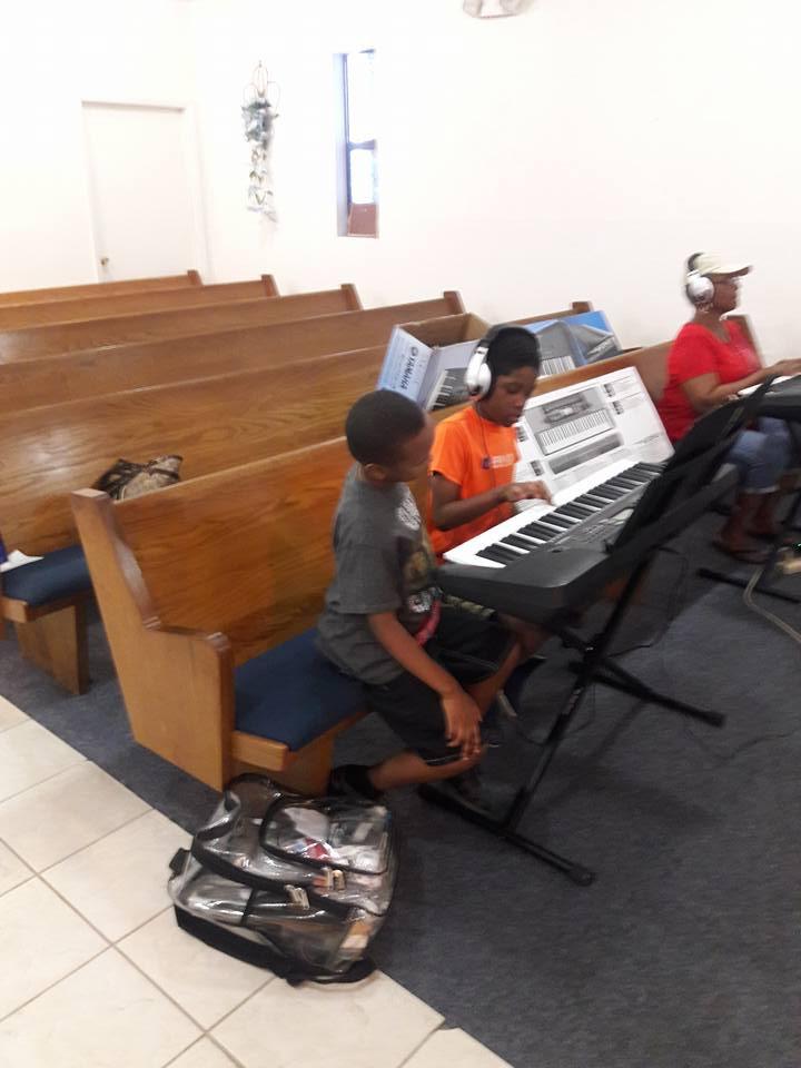 A-Stone Piano School Students playing keyboard
