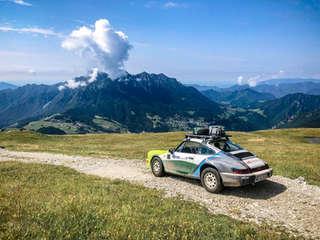 porsche 911 crossing alps in beautiful nature