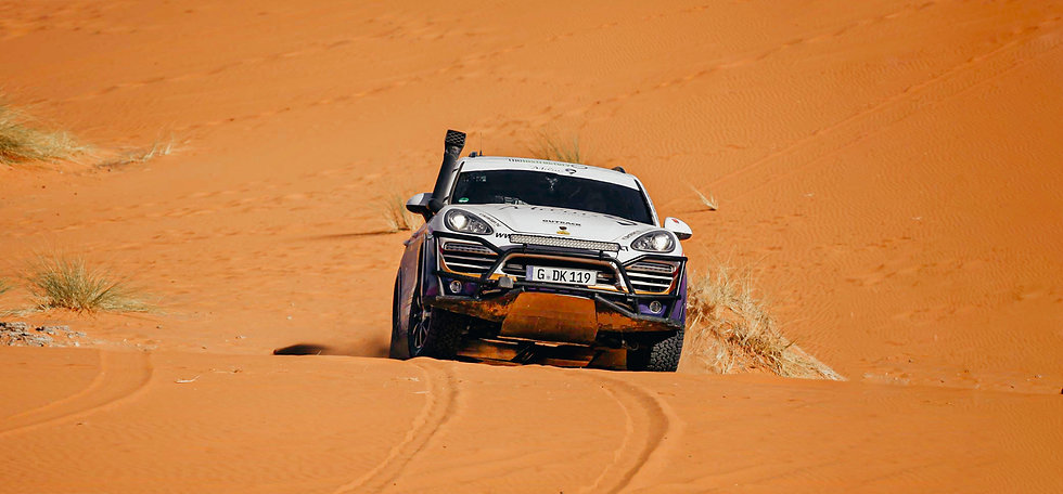 cayenne racing in sand dunes in africa