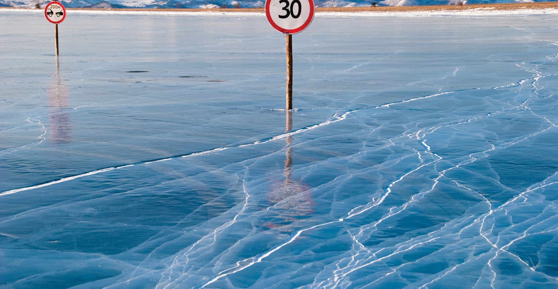 big frozen lake baikal with a road signs in the middle