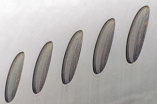porthole-windows-of-an-airplane-wet-weat