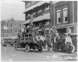 Truck on street near Litan Hotel carrying soldiers and African Americans during Tulsa, Okla., race r