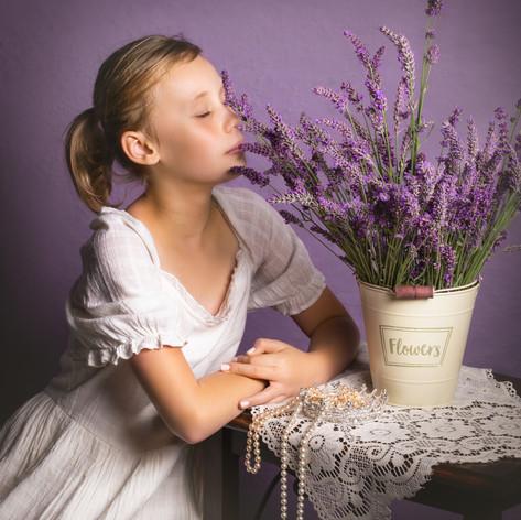 studio shot purple backdrop with lavende