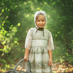 girl in the forest with a vintage basket