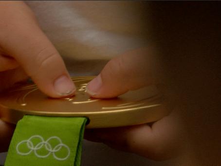 Olympic couple return home