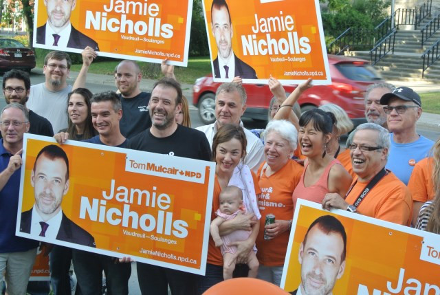 PHOTO BY JAMES ARMSTRONG  NDP supporters surround Federal MP Jamie Nicholls during the official opening of their campaign headquarters in Vaudreuil-Dorion.