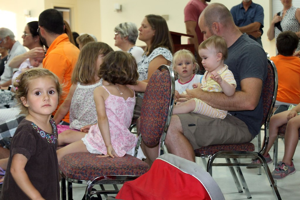 PHOTO BY CARMEN MARIE FABIO Nine young families were present at the Notre-Dame-de-l'Île-Perrot town council meeting July 12 to ask elected officials to take steps to address speeding motorists along a three-kilometre stretch of road that borders the shore of Lac St-Louis.