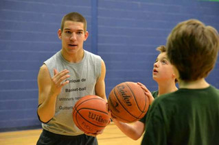 Sharing his success: St. Lazare's Charles Miller launches basketball camp