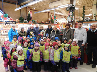 Pre-school tots and toddlers give gifts for those less fortunate this Christmas Two Hudson kindergar