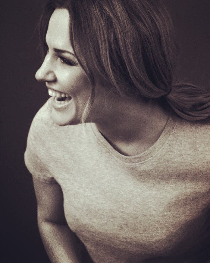 Professional portrait shot of Caroline Flack, smiling